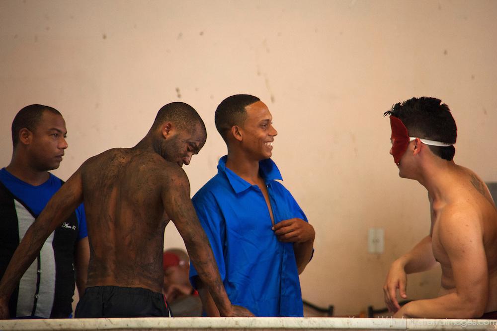 Central America, Cuba, Santa Clara. Cuban male performers backstage.