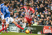 Accrington Stanley Forward, Jonathan Edwards (24) is tackles by Portsmouth Defender, Christian Burgess (6) during the EFL Sky Bet League 2 match between Portsmouth and Accrington Stanley at Fratton Park, Portsmouth, England on 11 February 2017. Photo by Adam Rivers.