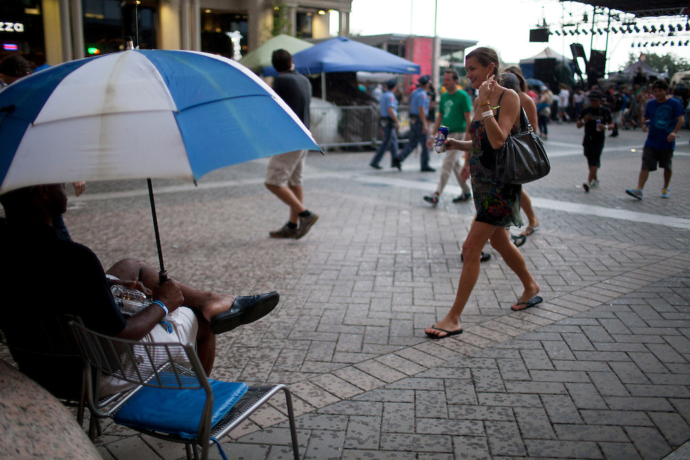 Fans hustle for shelter as the rain starts to fall on city plaza, Hopscotch Music Festival, Raleigh, N.C., September 8, 2012
