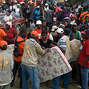 CARE distributed mattresses to displaced people in a rural area outside of Leogane.
