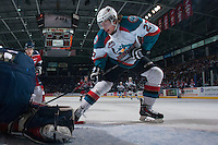 KELOWNA, CANADA - MARCH 22: Ryan Olsen #27 of the Kelowna Rockets digs for the puck in front of the net against the Tri-City Americans  on March 22, 2014 at Prospera Place in Kelowna, British Columbia, Canada.   (Photo by Marissa Baecker/Shoot the Breeze)  *** Local Caption *** Ryan Olsen;