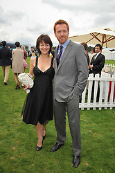 DAMIEN LEWIS and HELEN McCRORY at the 25th annual Cartier International Polo held at Guards Polo Club, Great Windsor Park, Berkshire on 26th July 2009.