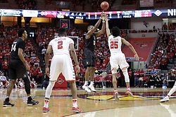 20 March 2017:  Madison Williams(25) steps in as Matt Williams offers a shot during a College NIT (National Invitational Tournament) 2nd round mens basketball game between the UCF (University of Central Florida) Knights and Illinois State Redbirds in  Redbird Arena, Normal IL