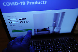 A vaccination clinic offering a Covid-19 home testing kit to purchase on their website, in London, as the UK continues in lockdown to help curb the spread of the coronavirus.