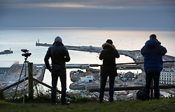 © Licensed to London News Pictures. 01/01/2019. Dover, UK. Photographers and TV crews watch for activity in the Channel from Dover as Border Force monitors shipping in the middle of the English Channel.  As the number of migrants willing to risk crossing the English Channel from France continues to grow, the UK government have increased the number of Border Force Cutters available to three.  Photo credit: Peter Macdiarmid/LNP