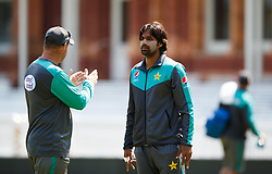 Pakistan's Rahat Ali (right) chats with coach Mickey Arthur during the nets session at Lord's, London.