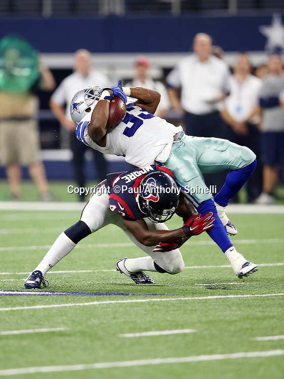 Dallas Cowboys running back Ben Malena (33) gets upended on a fourth quarter run by Houston Texans defensive back Corey Moore (43) during the 2015 NFL preseason football game against the Houston Texans on Thursday, Sept. 3, 2015 in Arlington, Texas. The Cowboys won the game 21-14. (©Paul Anthony Spinelli)