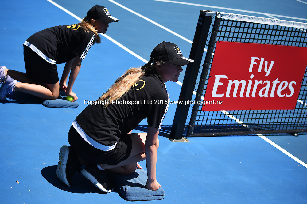 Emirates sponsorship and ball girls during a first round singles match at the ASB Classic Tennis Men's tournament. ASB Tennis Centre, Stanley st, Auckland, New Zealand. Monday 11 January 2016. Copyright Photo: Andrew Cornaga / www.photosport.nz