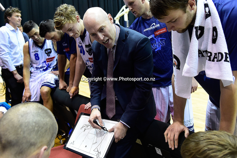 Head coach of the Giants Liam Flynn talks to his team during a NBL - Saints vs Giants semi final four basketball match at the TSB Arena in Wellington on Friday the 4th of July 2014. Photo by Marty Melville/www.Photosport.co.nz