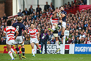 Scotland's Tommy Seymour and Japan's Kenki Fukuoka compete for the ball during the Rugby World Cup Pool B match between Scotland and Japan at the Kingsholm Stadium, Gloucester, United Kingdom on 23 September 2015. Photo by Shane Healey.