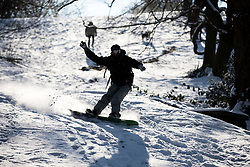 © Licensed to London News Pictures. 28/02/2018. London, UK. Charlie from Charlton snowboards in Greenwich Park following heavy snowfall and sub zero temperatures overnight. The cold weather originating in Siberia has been dubbed 'the Beast from the East'.  Photo credit : Tom Nicholson/LNP