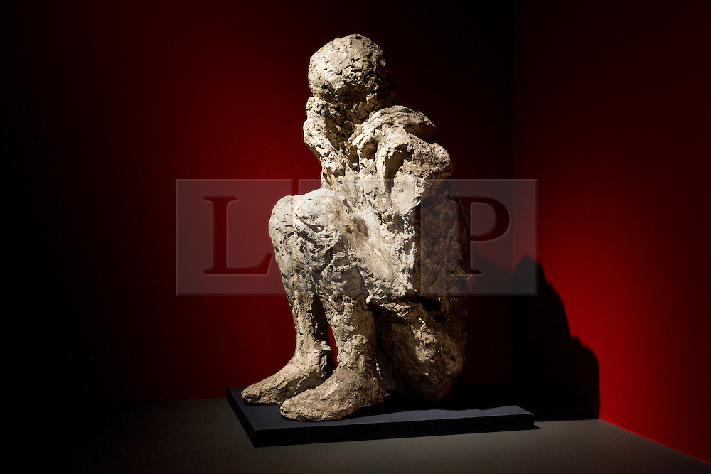 © Licensed to London News Pictures. 26/03/2013. London, UK. The plaster cast of male victim of the Pompeii disaster who was found crouched next to a wall, and known as 'The muleteer', is seen at the press view for a new exhibition at the British Museum in London today (26/03/2013). The exhibition, entitled 'Life and Death: Pompeii and Herculaneum', runs from the 28th of March to the 29th of September 2013 and looks at life in the Bay of Naples before and a the time of the catastrophic eruption of Mount Vesuvius; which buried the Roman towns of Pompeii and Herculaneum over 1600 years ago. Photo credit: Matt Cetti-Roberts/LNP