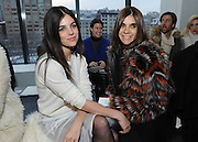 Carine Roitfeld, right, and her daughter Julia Restoin Roitfeld pose for a photograph before the Altuzarra Fall 2014 collection is presented during Fashion Week in New York, Saturday, Feb. 8, 2014. (AP Photo/Diane Bondareff)
