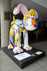 "© Licensed to London News Pictures. 29/06/2013. Bristol, UK. ""Bumble Boogie"", designed by Jools Holland and Sarah Jane Richards, one of the Gromit Unleashed sculptures are placed around Bristol, this one at the Colston Hall.  From Monday 1st July, Bristol will be home to 80 iconic giant Gromit sculptures as our public arts trail Gromit Unleashed takes to the streets.  The 5 foot high sculptures which have been painted by artists will be placed in various locations around Bristol and will eventually be auctioned for charity.  All proceeds from Gromit Unleashed will benefit Wallace & Gromit's Grand Appeal, the Bristol Children's Hospital Charity.  Gromit is a character from the popular Aardman Animation series of films and was designed by Nick Park.  29 June 2013.<br /> Photo credit : Simon Chapman/LNP"