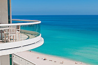 Balcony over the beach in Miami, relaxing tourists in the beach.