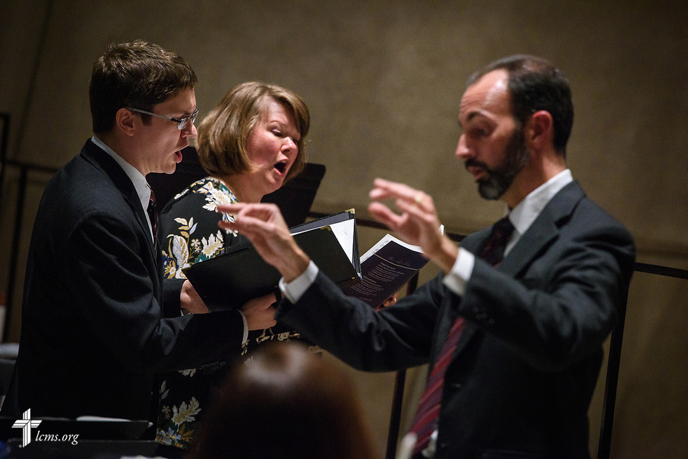 Katie Schuermann and David Solum sing during the 500th Anniversary of the Reformation service on Tuesday, Oct. 31, 2017, at Concordia Theological Seminary, Fort Wayne, Ind. Kantor Kevin Hildebrand conducts in front. LCMS Communications/Erik M. Lunsford