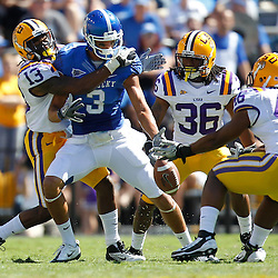 October 1, 2011; Baton Rouge, LA, USA;  LSU Tigers cornerback Ron Brooks (13) breaks up a pass intended for Kentucky Wildcats wide receiver Matt Roark (3) during the fourth quarter at Tiger Stadium. LSU defeated Kentucky 35-7. Mandatory Credit: Derick E. Hingle-US PRESSWIRE / © Derick E. Hingle 2011