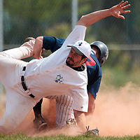 25 April 2010: Benjamin Deruelle of the PUC catches the ball as he jumps over Joris Bert of Rouen during game 1/week 3 of the French Elite season won 12-4 by Rouen over the PUC, at the Pershing Stadium in Vincennes, near Paris, France.