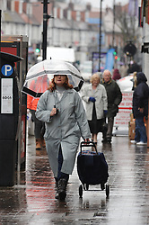 © Licensed to London News Pictures. 30/01/2014<br /> Wet and cold weather conditions continue across the UK. <br /> Rainy weather this afternoon (30.01.2014) as shoppers get wet at Orpington High Street, Kent.<br /> Photo credit :Grant Falvey/LNP