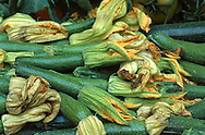 Zucchini with the flower head at the fresh produce stand in Naples, Italy.
