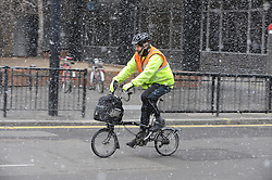 © Licensed to London News Pictures. 11/03/2013.Snow Today (11.03.13) in the City of London..Spring snow in the City near Aldgate Station..Photo credit : Grant Falvey/LNP