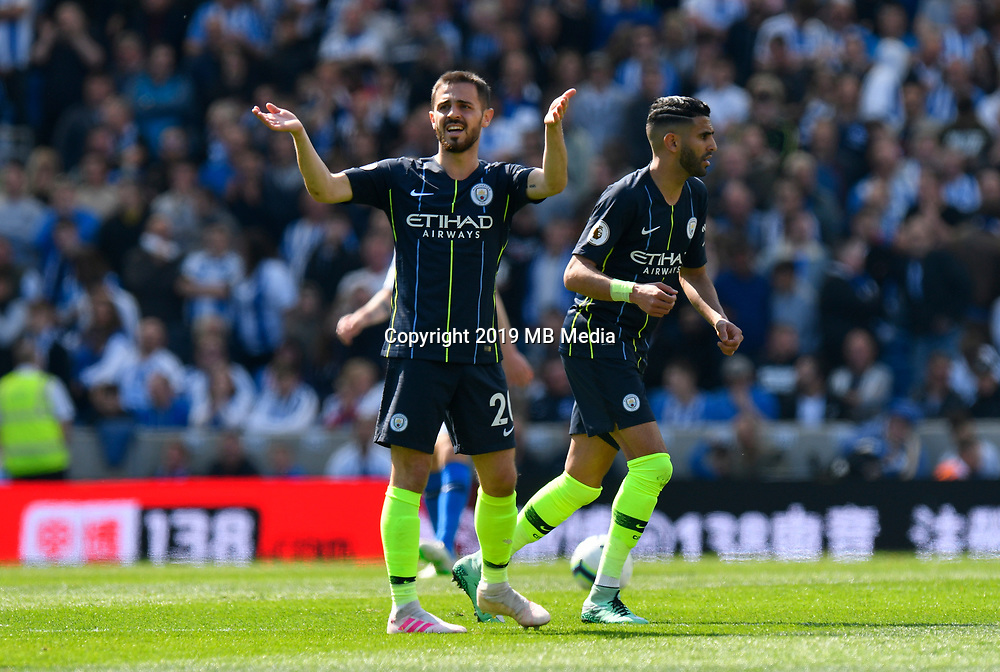 BRIGHTON, ENGLAND - MAY 12:  Bernardo Silva (20) of Manchester City urges on the crowd after Sergio Aguero (10) of Manchester City scores a goal to make the score 1-1 during the Premier League match between Brighton & Hove Albion and Manchester City at American Express Community Stadium on May 12, 2019 in Brighton, United Kingdom. (MB Media)