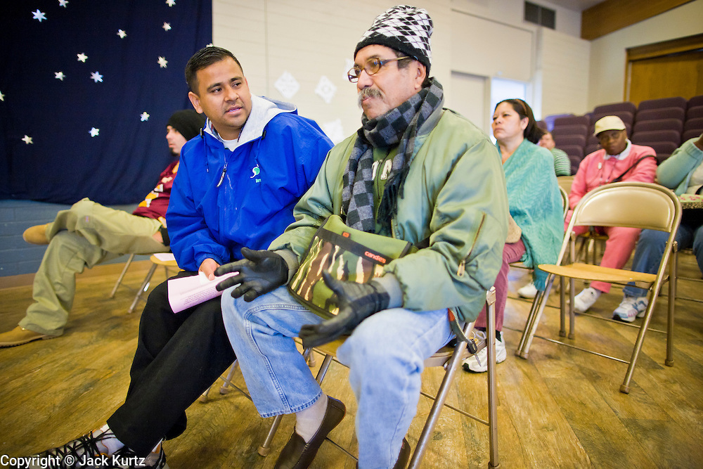 08 DECEMBER 2010 - PHOENIX, AZ:  ANGEL JAIMES (left) and CARLOS HONDEROW, both from Phoenix, wait to see doctors at a Mission of Mercy mobile clinic in Phoenix, AZ, Wednesday, Dec. 8. Mission of Mercy has been providing free medical help for people in the Phoenix area since 1997. In the last two years, as the Arizona economy continued its recessionary slide, patient load at the clinics has more than doubled. Mission of Mercy, which relies on voluntary medical help and financial donations, recently acquired another mobile clinic so they could expand their reach into suburban areas they previously had not served. Mission of Mercy has provided free medical help to more than 43,000 patients in the Phoenix area since 1997.    PHOTO BY JACK KURTZ