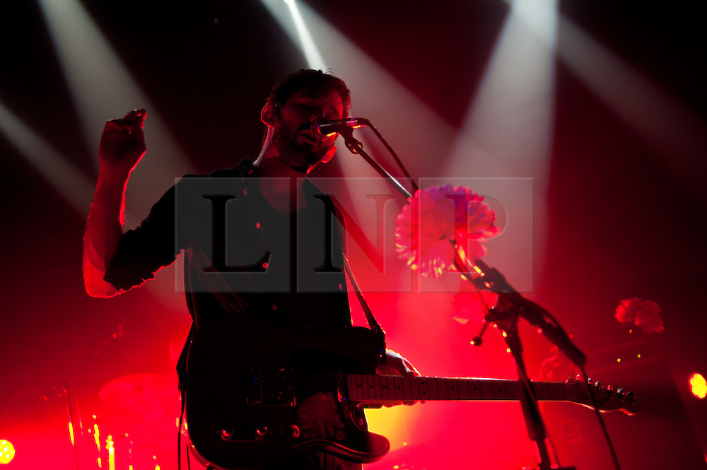 © Licensed to London News Pictures. 26/04/2012. London, UK. The Antlers perform at Shepherds Bush Empire.  The Antlers are an indie-rock band based in Brooklyn, New York.  They are touring to support their third album, Burst Apart.  Initially, The Antlers was a solo project created by vocalist and guitarist Peter Silberman immediately after he had moved to Brooklyn, New York City. Silberman wrote the first two albums, Uprooted and In the Attic of the Universe by himself. Afterwards, he recruited Michael Lerner (drums) and Darby Cicci (keyboards), becoming a collaborative group.  In this picture - Peter Silberman.  Photo credit : Richard Isaac/LNP