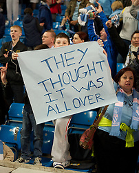MANCHESTER, ENGLAND - Monday, April 30, 2012: A Manchester City supporter with a banner 'They Thought It Was All Over' after their 1-0 victory over Manchester United put them back on top of the table after the Premiership match at the City of Manchester Stadium. (Pic by David Rawcliffe/Propaganda)