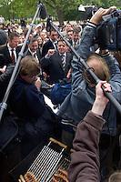 12 MAY 2004, LUDWIGSFELDE/GERMANY:<br /> Gerhard Schroeder (M), SPD, Bundeskanzler, - umgeben von Journalisten - an einem anl. seines Besuches eingerichteten Grillwurststand, Gesamtschule Ludwigsfelde, <br /> Gerhard Schroeder, Federal Chancellor, during a visit of a school near Berlin<br /> IMAGE: 20040512-02-033<br /> KEYWORDS: Gerhard Schröder, Schule, Schüler, Fotografen, photographer, pupil, pupils