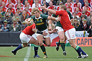 Wynand Olivier of the Springboks is tackled by Jamie Heaslip and Matthew Rees of the Lions. <br /> Rugby - 090704 - Springboks vs British&Irish Lions - Coca-Cola Park - Johannesburg - South Africa. The Lions won the third test 28-9 but lost the series 2-1 to the Springboks.<br /> Photographer : Anton de Villiers / SASPA