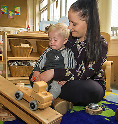 Pictured: Kyle Ebbs (15 months) and his mother Abby<br /> Today social security minister Jeane Freeman MSP visited voluntary organisation  Stepping Stones (North Edinburgh), a group which helps young parent families and pregnant women, and met parents and children. The visit marked the introduction of the first Social Security (Scotland) Bill.<br /> Ger Harley | EEm 21 June  2017