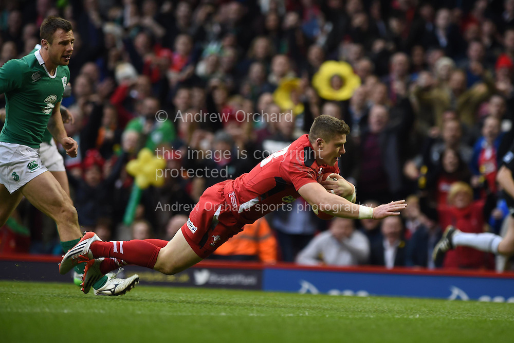 Scott Williams of Wales dives over to score his teams 1st try. RBS Six nations 2015 championship, Wales v Ireland  at the Millennium stadium in Cardiff, South Wales on Saturday 14th March 2015<br /> pic by Andrew Orchard, Andrew Orchard sports photography.