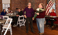 Debbie Gibson is honored with flowers from Rick Leahy during the Laconia Rotary luncheon at the Belknap Mill Thursday afternoon.  (Karen Bobotas/for the Laconia Daily Sun)