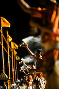 Hindu priests perform at an evening puja ceremony along the banks of the Ganges River in Varanasi, India.