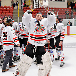 FORT FRANCES, ON - May 2, 2015 : Central Canadian Junior &quot;A&quot; Championship, game action between the Fort Frances Lakers and the Soo Thunderbirds, Championship game of the Dudley Hewitt Cup. Brian Kment #35 of the Soo Thunderbirds raises the Dudley Hewitt Cup.<br /> (Photo by Shawn Muir / OJHL Images)