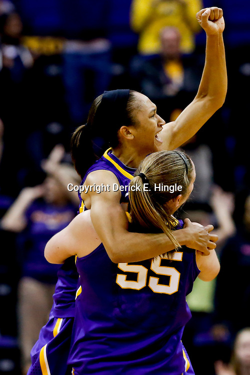 Mar 26, 2013; Baton Rouge, LA, USA; LSU Tigers guard Adrienne Webb (10) celebrates with teammate forward Theresa Plaisance (55) after a win over the Penn State Lady Lions during the second round of the 2013 NCAA womens basketball tournament at Pete Maravich Assembly Center. LSU defeated Penn State 71-66. Mandatory Credit: Derick E. Hingle-USA TODAY Sports