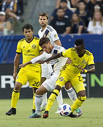 July 7, 2018 - Carson, California, U.S - Jonathan dos Santos #8 of the LA Galaxy battles for the ball in between two Columbus Crew defenders during their MLS game on Saturday July 7, 2018 at StubHub Center in Carson, California. LA Galaxy defeats Crew, 4-0. (Credit Image: © Prensa Internacional via ZUMA Wire)
