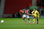 Tareiq Holmes-Dennis of Bristol Rovers fouls Mallik Wilks of Doncaster Rovers by pulling back on his shirt during the EFL Sky Bet League 1 match between Doncaster Rovers and Bristol Rovers at the Keepmoat Stadium, Doncaster, England on 26 March 2019.