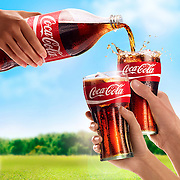Pouring Coca-Cola into two raised glasses Ray Massey is an established, award winning, UK professional  photographer, shooting creative advertising and editorial images from his stunning studio in a converted church in Camden Town, London NW1. Ray Massey specialises in drinks and liquids, still life and hands, product, gymnastics, special effects (sfx) and location photography. He is particularly known for dynamic high speed action shots of pours, bubbles, splashes and explosions in beers, champagnes, sodas, cocktails and beverages of all descriptions, as well as perfumes, paint, ink, water – even ice! Ray Massey works throughout the world with advertising agencies, designers, design groups, PR companies and directly with clients. He regularly manages the entire creative process, including post-production composition, manipulation and retouching, working with his team of retouchers to produce final images ready for publication.