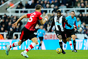Allan Saint-Maximin (#10) of Newcastle United bares down on Jan Bednarek (#35) of Southampton during the Premier League match between Newcastle United and Southampton at St. James's Park, Newcastle, England on 8 December 2019.