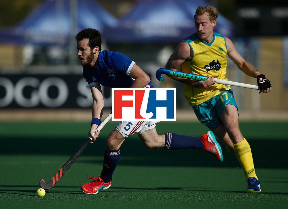 JOHANNESBURG, SOUTH AFRICA - JULY 11: Jean-Laurent Kieffer of France runs with the ball under pressure from Aran Zalewski of Australia during day 2 of the FIH Hockey World League Semi Finals Pool A match between Australia and France at Wits University on July 11, 2017 in Johannesburg, South Africa. (Photo by Jan Kruger/Getty Images for FIH)