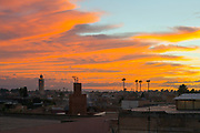 Marrakesh skyline, vivid orange red sunset over the silhouetted Koutoubia Mosque and Jemaa el Fna market square, Marrakesh, Morocco, North Africa, 2015–10-21.