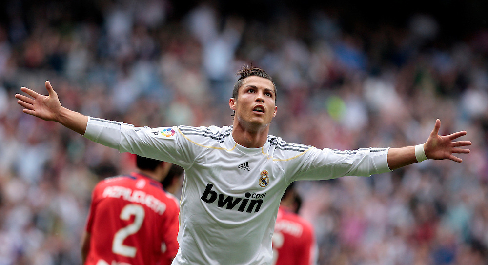 Real Madrid's  Cristiano Ronaldo from Portugal celebrates after scoring against Osasuna during a Spanish La Liga soccer match at the Santiago Bernabeu stadium in Madrid, Sunday, May 2, 2010.