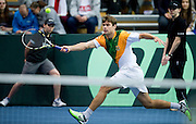 Ruan Roelofse of South Africa competes at single match during third day of the BNP Paribas Davis Cup 2013 between Poland and South Africa at MOSiR Hall in Zielona Gora on April 07, 2013...Poland, Zielona Gora, April 07, 2013..Picture also available in RAW (NEF) or TIFF format on special request...For editorial use only. Any commercial or promotional use requires permission...Photo by © Adam Nurkiewicz / Mediasport