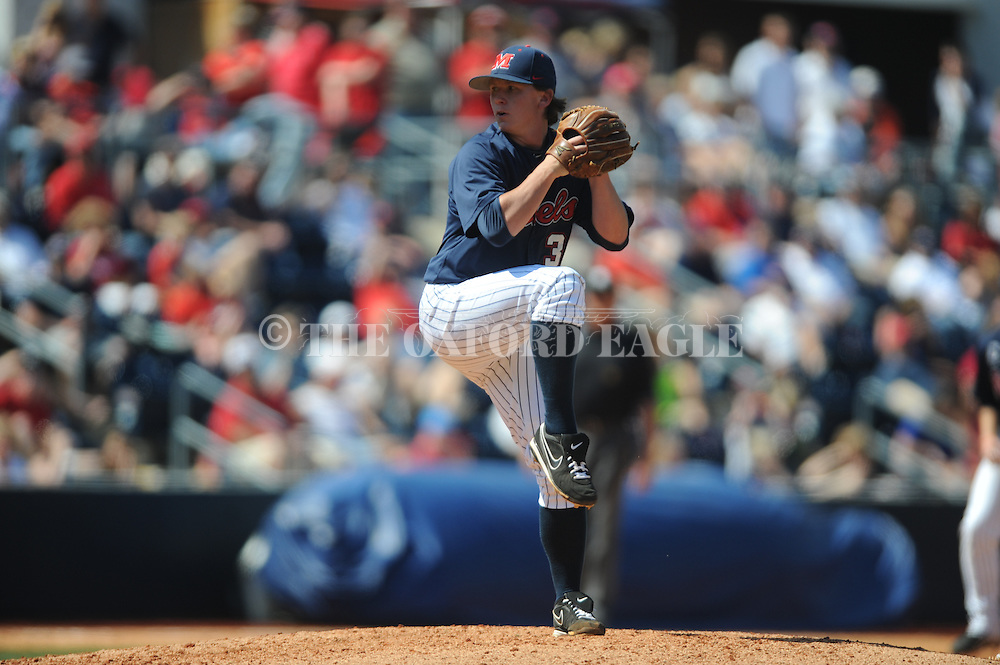 Mississippi's Wyatt Short pitches vs. LSU at Oxford-University Stadium in Oxford, Miss. on Saturday, April 19, 2014. (AP Photo/Oxford Eagle, Bruce Newman)