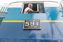 © Licensed to London News Pictures. 26/12/2014. Sri Lanka, UK 10th year commemorations of the Indian Ocean Tsunami, in Sri Lanka. In Peraliya, a train was derailed by a 20m high tsunami wave with the loss of 1500 lives. Although many of the carriages have been destroyed, engine '591', also known as 'Queen of the Sea' was completely restored and on every 'tsunami day' the train runs the original route from Colombo to her original resting place that is now a permanent memorial. Photo credit : Sam Spickett/LNP