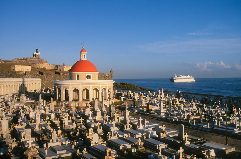 Old San Juan, Puerto Rico: San Juan cemetery, El Morro fortress and lighthouse.with cruise ship approaching San Juan Harbor.