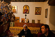 A nun from Vienna visits Father Milenko at Sveti  Stefan church in the center of Velika Hoca on Christmas Eve...Orthodox Christmas (January 7) in the Serbian village of Velika Hoca, Kosovo.