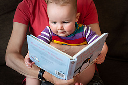 A mother and baby reading at home in London.  Picture date: Sunday May 10, 2020. Photo credit should read: Matt Crossick/Empics